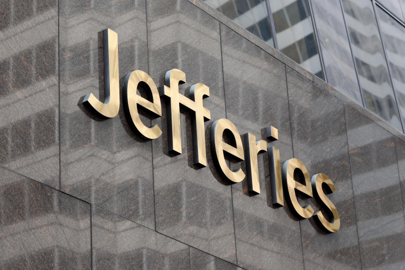 FILE - This May 23, 2019, file photo shows the logo for the Jefferies Financial Group in New York. Jefferies Financial Group announced Sunday, March 29, 2020, that its chief financial officer, Peregrine C. Broadbent, died Sunday from coronavirus complications. He was 56. (AP Photo/Richard Drew, File)