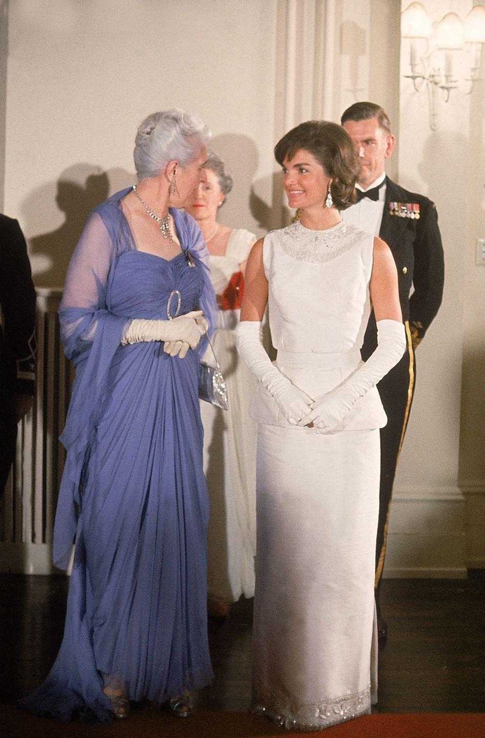 <p>Jackie Kennedy looks stunning in a white taffeta column evening gown for a state reception in Ottawa, Canada in 1961. </p>