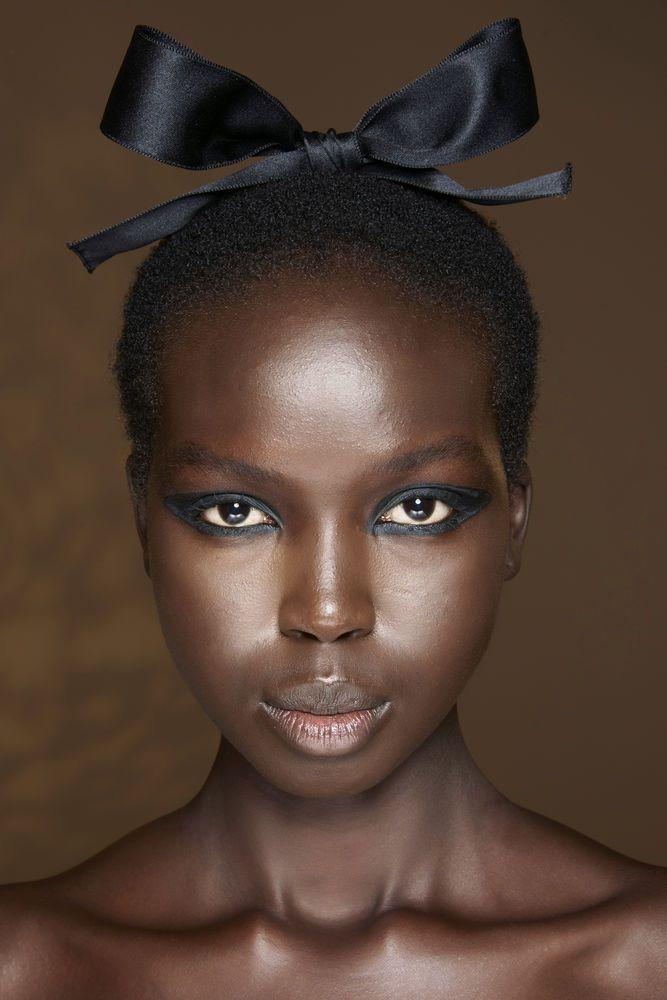 <p>In recent years we've come to stick to either a feline flick or shading our bottom lashes with a bit of eyeliner, but the Nineties was about tightlining all the way around the eye for a standout statement, as seen at Dior. </p>