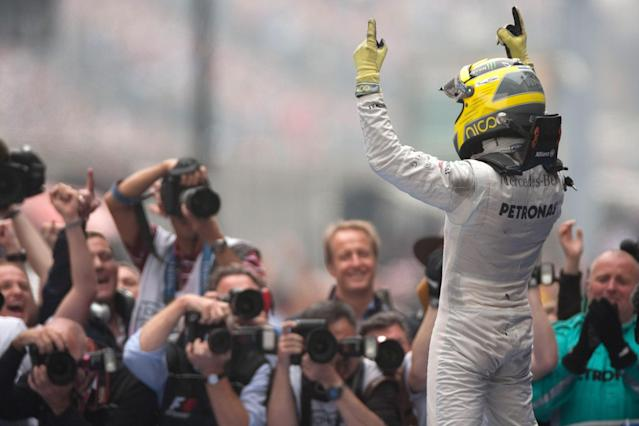 SHANGHAI, CHINA - APRIL 15: Nico Rosberg of Mercedes and Germany celebrates after winning the Chinese Formula One Grand Prix at the Shanghai International Circuit on April 15, 2012 in Shanghai, China. (Photo by Peter J Fox/Getty Images)