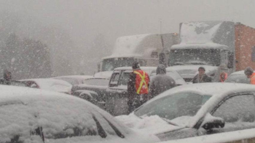 Dozens of vehicles are involved in a major pileup on Highway 401 east of Toronto