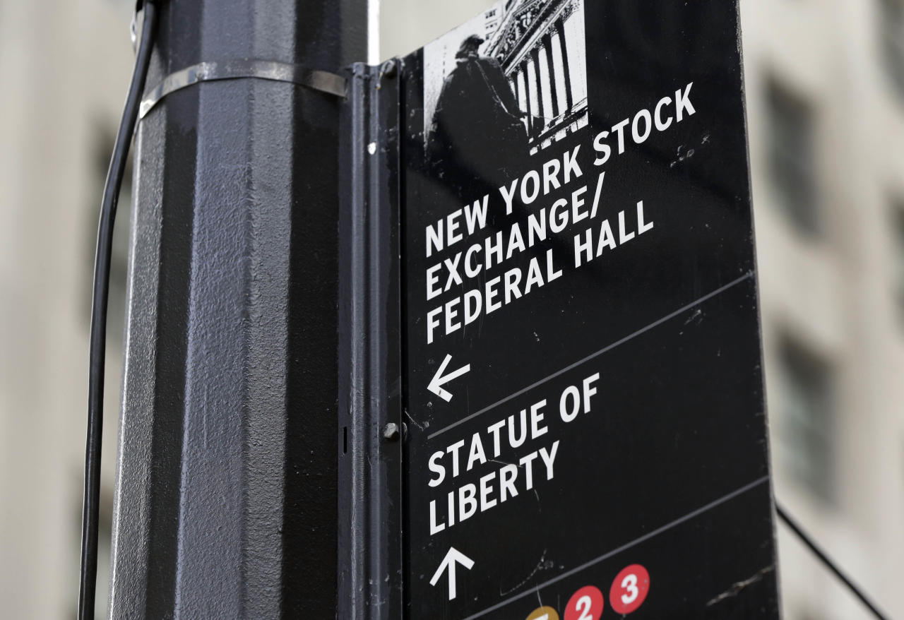 <p> FILE - In this Thursday, Oct. 2, 2014, file photo, a street sign directs people to the New York Stock Exchange, Federal Hall, and the Statue of Liberty, in New York's Financial District. Gains by technology companies and banks helped lift U.S. stocks higher in early trading Thursday, Dec. 14, 2017. (AP Photo/Richard Drew, File) </p>