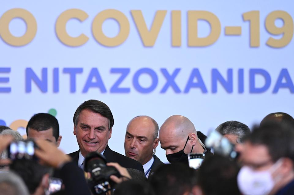 Brazil's President Jair Bolsonaro reacts after attending the COVID-19 Clinical Study result announcement at the Planalto Palace in Brasilia, Brazil, on October 19, 2020. (Photo by Andre Borges/NurPhoto via Getty Images)
