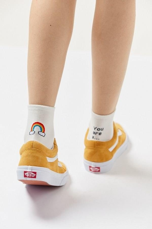 "$9.99, Urban Outfitters. <a href=""https://www.urbanoutfitters.com/shop/ankle-verbiage-crew-sock?category=SEARCHRESULTS&color=011"">Get it now!</a>"