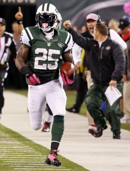 New York Jets running back Joe McKnight (25) runs back a kick return 100 yards for a touchdown during the second half of an NFL football game against the Houston Texans, Monday, Oct. 8, 2012, in East Rutherford, N.J. (AP Photo/Julio Cortez)