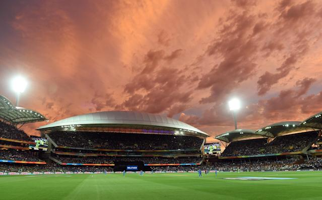 A general view shows the scene as the sun sets, at the Adelaide Oval during the 2015 Cricket World Cup match between India and Pakistan in Adelaide on February 15, 2015 (AFP Photo/William West)