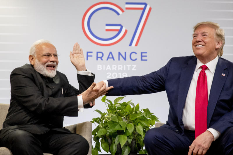 Indian Prime Minister Narendra Modi, left, slaps the hand of President Donald Trump as they share a laugh during a bilateral meeting at the G-7 summit in Biarritz, France, Monday, Aug. 26, 2019. (AP Photo/Andrew Harnik)