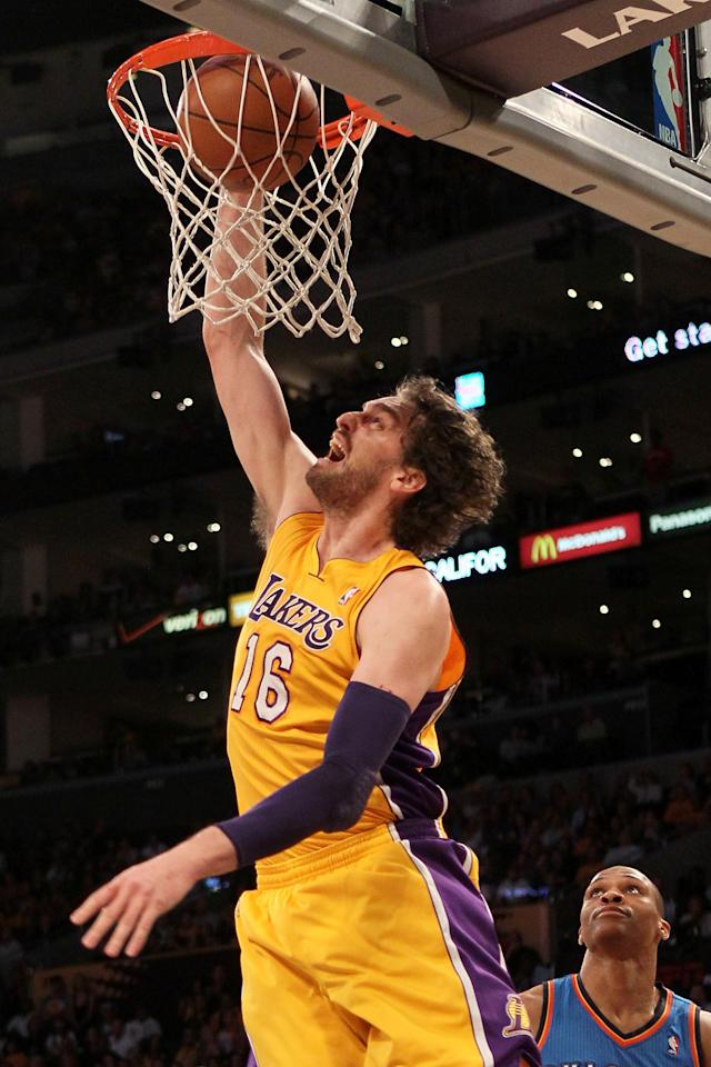 LOS ANGELES, CA - MAY 19:  Pau Gasol #16 of the Los Angeles Lakers dunks the ball in front of Russell Westbrook #0 of the Oklahoma City Thunder in the first quarter in Game Four of the Western Conference Semifinals in the 2012 NBA Playoffs on May 19 at Staples Center in Los Angeles, California. NOTE TO USER: User expressly acknowledges and agrees that, by downloading and or using this photograph, User is consenting to the terms and conditions of the Getty Images License Agreement.  (Photo by Stephen Dunn/Getty Images)