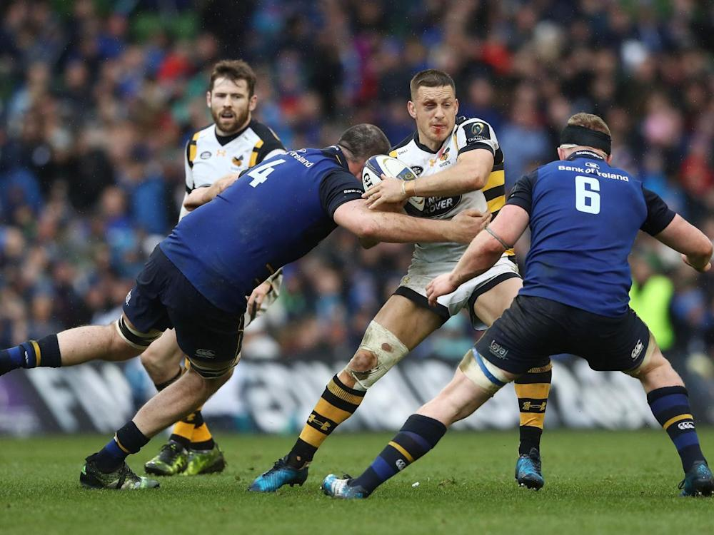 Jimmy Gopperth of Wasps is tackled by Devin Toner and Dan Leavy (Getty)