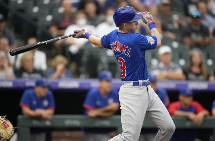 Chicago Cubs' Frank Schwindel follows the flight of his double off Colorado Rockies starting pitcher Kyle Freeland in the second inning of a baseball game Tuesday, Aug. 3, 2021, in Denver. (AP Photo/David Zalubowski)
