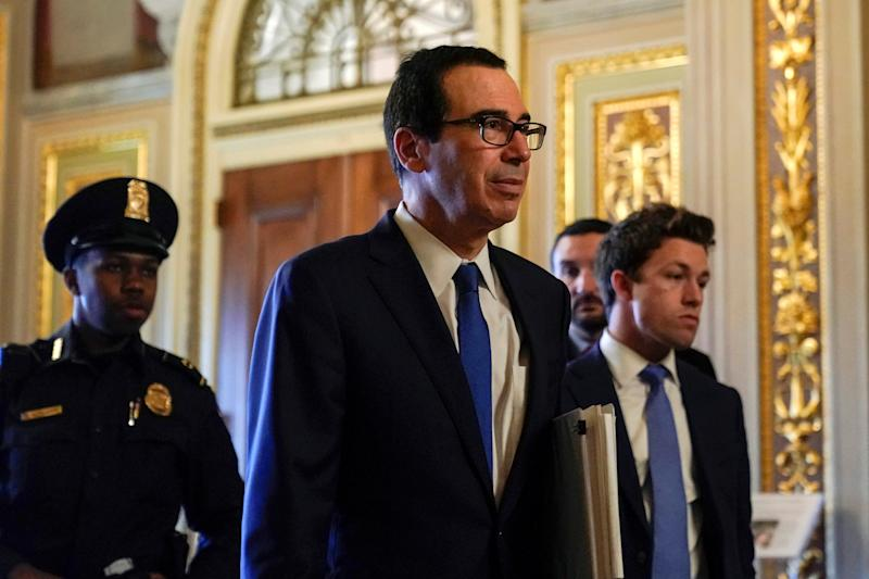 U.S. Secretary of the Treasury Mnuchin walks to the meeting for a coronavirus relief package in Washington