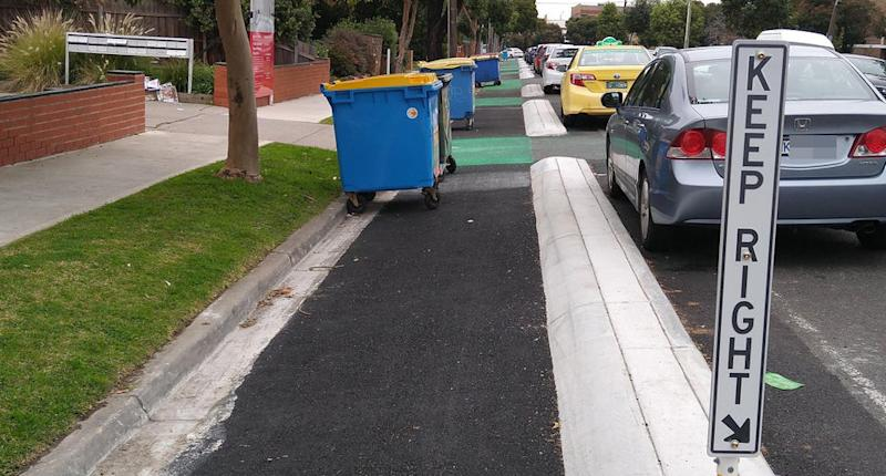 Eldridge Street in Footscray is pictured with large bins sitting in the bike lane.