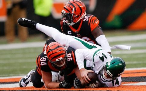 New York Jets quarterback Sam Darnold (14) is sacked by Cincinnati Bengals strong safety Shawn Williams (36) during the second half of an NFL football game, Sunday, Dec. 1, 2019, in Cincinnati - Credit: AP