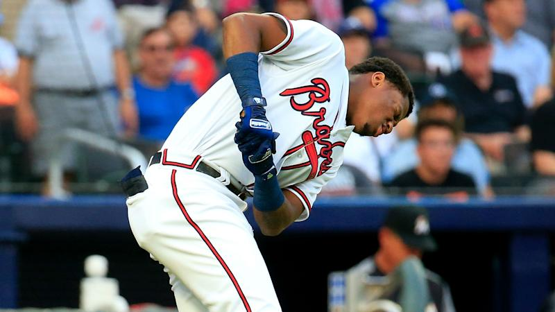 Braves survive skirmish, loss of Acuna to top Marlins