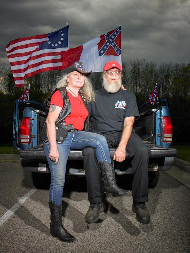 "<p>""Wayne Byrd, president of the Heritage Preservation Association, and his wife, Susan. The group gathers every Saturday outside the Danville Museum of Fine Arts and History to protest its removal of the Third National Flag of the Confederacy, a gift from the association. They voted for Trump."" (Photograph and caption by Naomi Harris) </p>"