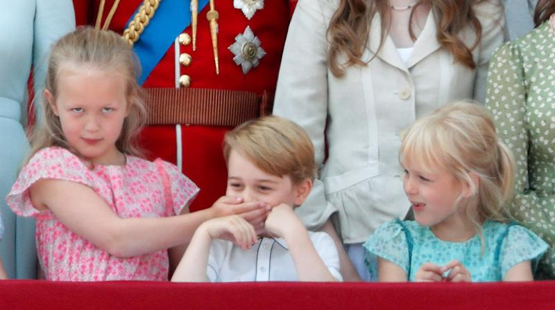 Savannah Phillips puts her hand over Prince George's mouth to keep her younger cousin quiet at Trooping the Color. The parade marks the official birthday of the Sovereign, even though the Queen's actual birthday is on April 21.  (Max Mumby/Indigo via Getty Images)