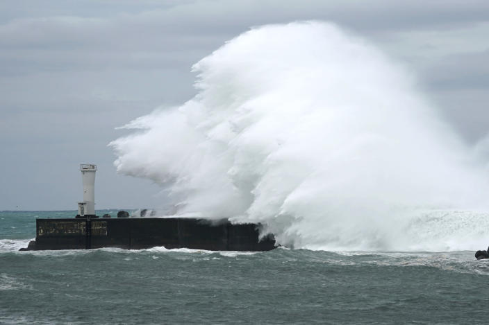 Surging waves hit against the breakwater while Typhoon Hagibis approaches at a port in town of Kiho, Mie prefecture, central Japan Friday, Oct. 11, 2019. A powerful typhoon is advancing toward the Tokyo area, where torrential rains are expected this weekend. (AP Photo/Toru Hanai)