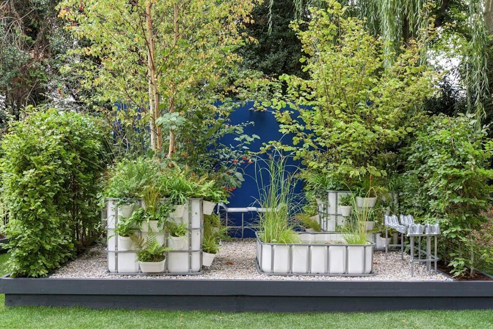 """<p>Inspired by the balconies of Milan's Bosco Verticale and tiny urban forests, this beautiful Container Garden aims to create a haven for wildlife. Cleverly, white bulk containers have been repurposed to create ponds for birds, butterflies and other insects. </p><p><strong>READ MORE:</strong> <a href=""""https://www.countryliving.com/uk/homes-interiors/gardens/g27536871/chelsea-flower-show-garden-trends/"""" rel=""""nofollow noopener"""" target=""""_blank"""" data-ylk=""""slk:8 Chelsea Flower Show 2021 gardening trends to try at home"""" class=""""link rapid-noclick-resp"""">8 Chelsea Flower Show 2021 gardening trends to try at home</a></p>"""