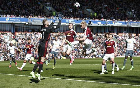 Britain Football Soccer - Burnley v Manchester United - Premier League - Turf Moor - 23/4/17 Manchester United's David De Gea gathers from Burnley's Ben Mee Reuters / Andrew Yates Livepic