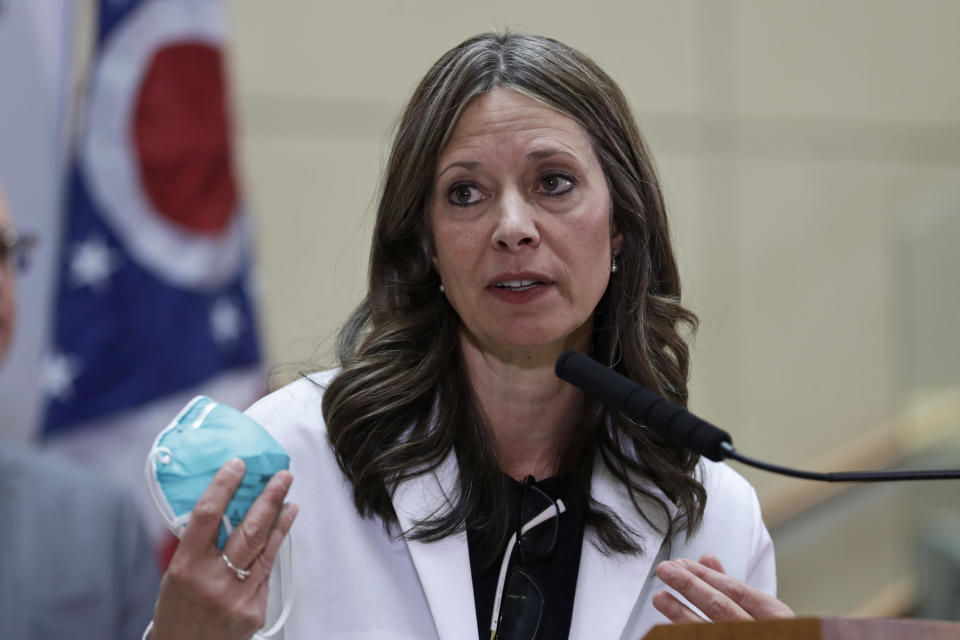 FILE - In this Feb. 27, 2020 file photo, Ohio Department of Health Director Dr. Amy Acton gives an update on the state's preparedness and education efforts to limit the spread of COVID-19, in Cleveland. Acton and six other people who risked their own health and safety to help and protect others during the coronavirus pandemic will receive special Profile in Courage awards next month, the John F. Kennedy Library Foundation announced Tuesday, May 4, 2021. (AP Photo/Tony Dejak, File)