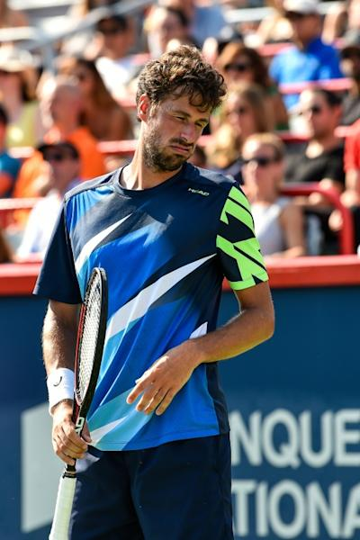 Robin Haase of Netherlands reacts after losing a point against Roger Federer of Switzerland during their ATP Rogers Cup semi-final match, at Uniprix Stadium in Montreal, Quebec, on August 12, 2017
