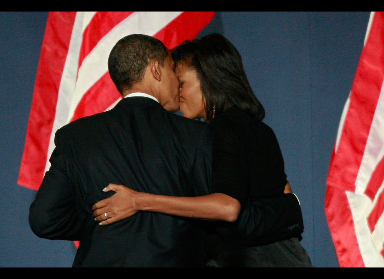 CHICAGO - NOVEMBER 04: U.S. President elect Barack Obama kisses his wife Michelle as they walk off the stage after Obama gave his victory speech during an election night gathering in Grant Park on November 4, 2008 in Chicago, Illinois. Obama defeated Republican nominee Sen. John McCain (R-AZ) by a wide margin in the election to become the first African-American U.S. President elect. (Photo by Scott Olson/Getty Images)