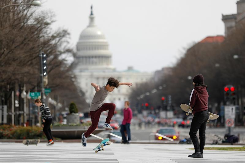 Kids perform skateboard tricks at Freedom Plaza, as Mayor Muriel Bowser declared a State of Emergency due to the coronavirus disease (COVID-19) in Washington, U.S., March 16, 2020. REUTERS/Tom Brenner TPX IMAGES OF THE DAY