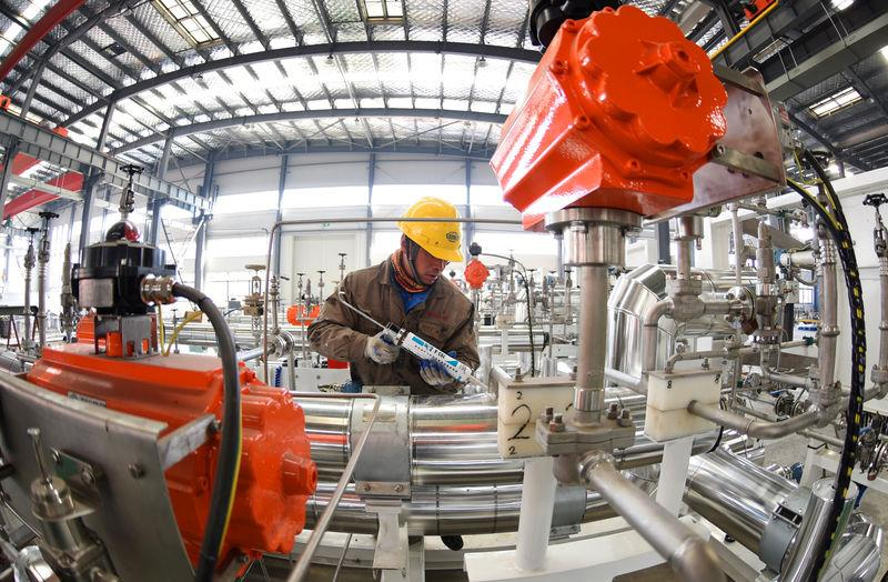 Man works on manufacturing LNG equipment at a factory of the COSCO Liquid Loading and Unloading Equipment company in Lianyungang, Jiangsu
