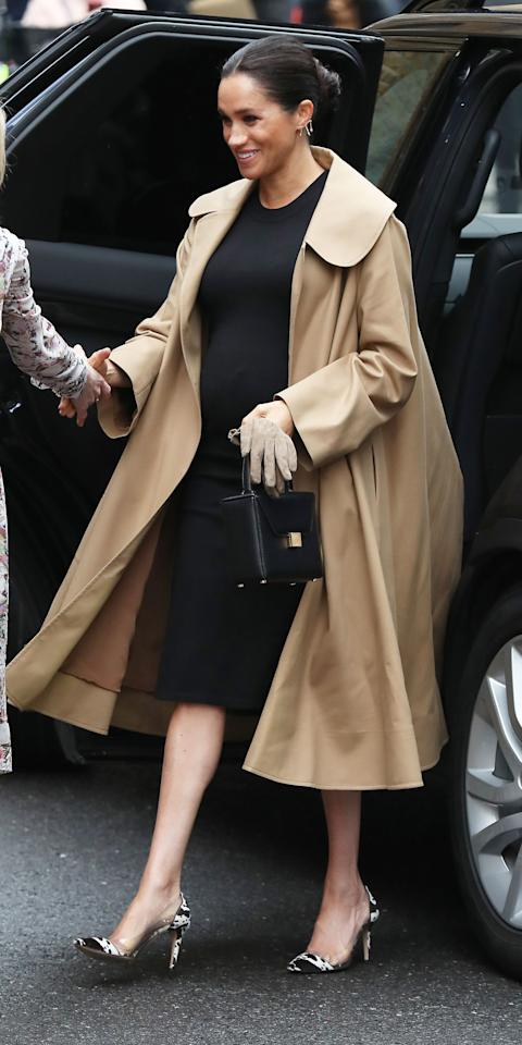 """<p>Meghan Markle visited Smart Works today, wearing a long shirt dress by Hatch ($218; <a rel=""""nofollow"""" href=""""https://click.linksynergy.com/fs-bin/click?id=93xLBvPhAeE&subid=0&offerid=640303.1&type=10&tmpid=23605&RD_PARM1=https%253A%252F%252Fwww.shopbop.com%252Feliza-dress-hatch%252Fvp%252Fv%253D1%252F1568079084.htm&u1=IS,MeghanMarkle,anesta,,IMA,3409877,201901,I"""">shopbop.com</a>), Oscar de la Renta coat ($2,990; <a rel=""""nofollow"""" href=""""http://www.pjtra.com/t/8-9035-131940-84605?sid=IS,MeghanMarkle,anesta,,IMA,3409877,201901,I&url=https%3A%2F%2Fwww.oscardelarenta.com%2Fcotton-twill-coat"""">oscardelarenta.com</a>), and cow print heels with clear panels on the side.</p>"""