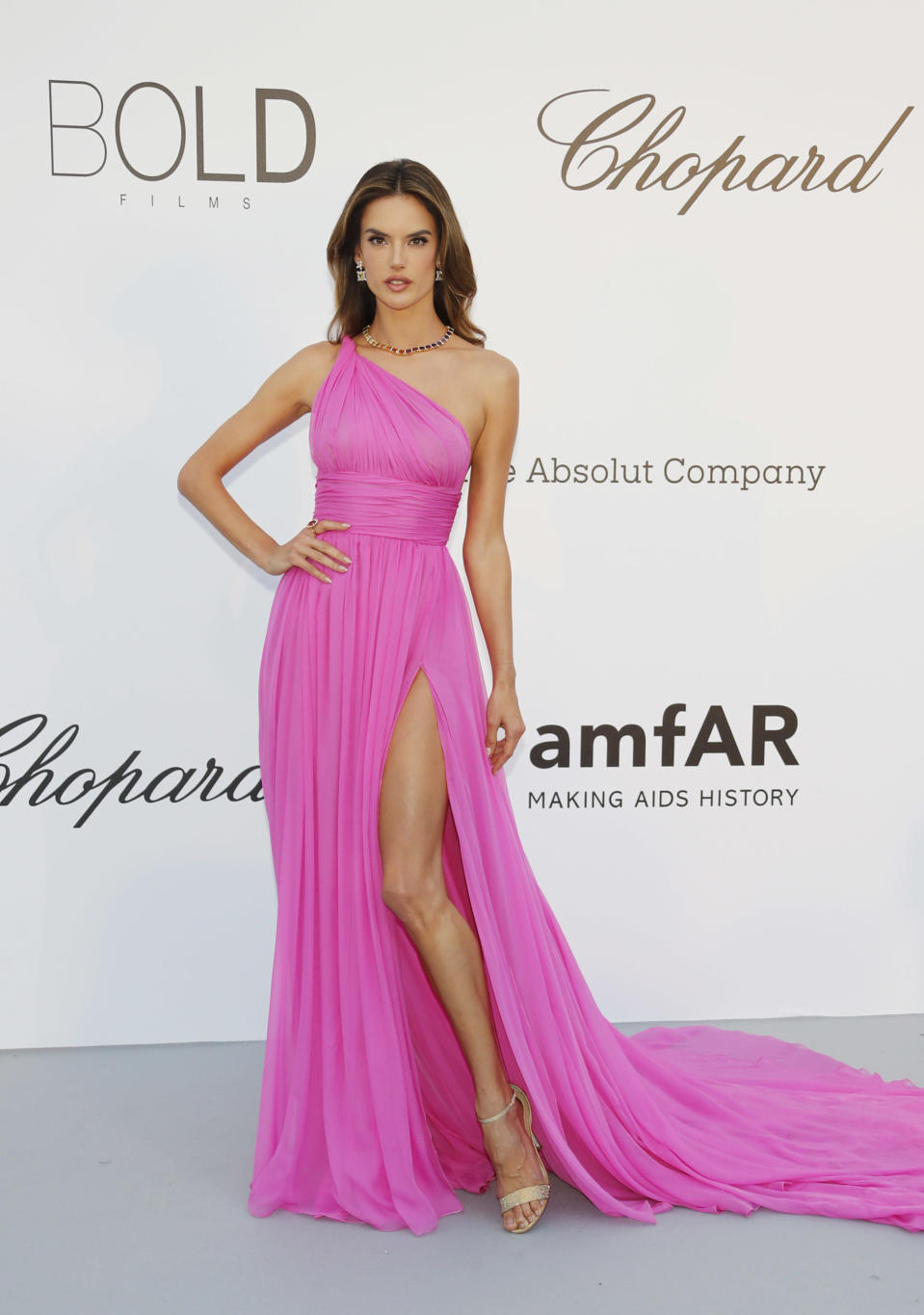 <p>Supermodel Alessandra Ambrosio opted for a hot pink one-shoulder gown at the amfAR Gala dinner. [Photo: Getty] </p>