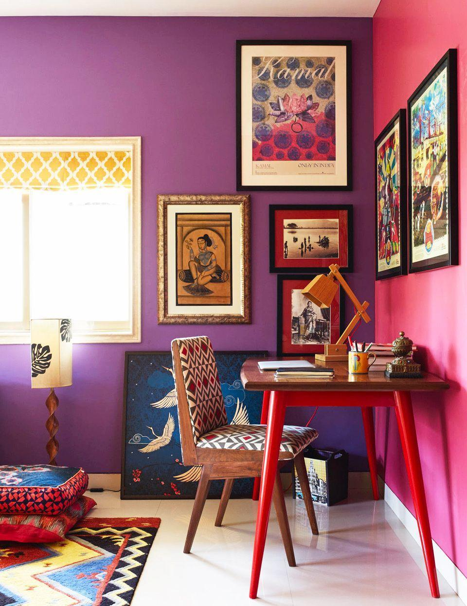 """<p>How about a vibrant fuchsia wall instead of that extra cup of coffee? Designer <a href=""""https://www.instagram.com/krsnaamehta/?hl=en"""" rel=""""nofollow noopener"""" target=""""_blank"""" data-ylk=""""slk:Krsnaa Mehta"""" class=""""link rapid-noclick-resp"""">Krsnaa Mehta</a> gave <a href=""""https://www.housebeautiful.com/design-inspiration/house-tours/a33549769/krsnaa-mehta-india-circus-home-tour-mumbai/"""" rel=""""nofollow noopener"""" target=""""_blank"""" data-ylk=""""slk:his"""" class=""""link rapid-noclick-resp"""">his</a> lackluster home office a surge of energy with jewel tone statement walls, plenty of artwork, and prints throughout. </p>"""