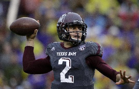 Texas A&M quarterback Johnny Manziel (2) passes in the first half of an NCAA college football game against LSU in Baton Rouge, La., Saturday, Nov. 23, 2013. (AP Photo/Gerald Herbert)