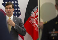 U.S. Secretary for Defense Mark Esper, left, prepares to greet Afghan Defense Minister Asadullah Khalid prior to a meeting at NATO headquarters in Brussels, Thursday, Feb. 13, 2020. NATO ministers, in a second day of meetings, will discuss building stability in the Middle East, the Alliance's support for Afghanistan and challenges posed by Russia's missile systems. (AP Photo/Virginia Mayo, Pool)