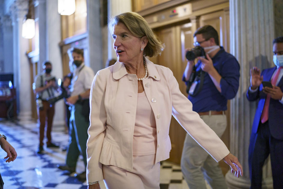 Sen. Shelley Moore Capito, R-W.Va., one of the key Senate Republicans shepherding a $1 trillion infrastructure bill with Democrats, arrives at the chamber as the Senate works to advance the $1 trillion bipartisan infrastructure bill, at the Capitol in Washington, Monday, Aug. 2, 2021. The 2,700-page bill includes new expenditures on roads, bridges, water pipes broadband and other projects, plus cyber security. (AP Photo/J. Scott Applewhite)