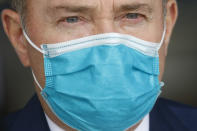 FILE - In this April 15, 2020, file photo, Utah Gov. Gary Herbert wears a mask during a news conference, in Salt Lake City. Herbert declared a state of emergency, Sunday, Nov. 8, 2020, and ordered a statewide mask mandate in an attempt to stem a surge in coronavirus patient hospitalizations that is testing the state's hospital capacity. (AP Photo/Rick Bowmer, File)