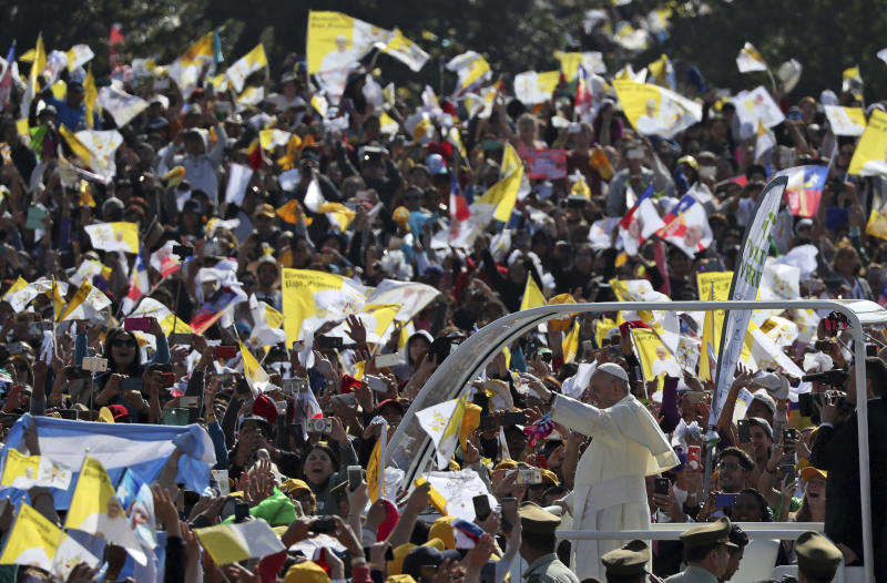 """Pope Francis arrives on his pope-mobile to celebrate Mass at O'Higgins Park in Santiago, Chile, Tuesday, Jan. 16, 2018. Francis begged for forgiveness Tuesday for the """"irreparable damage"""" done to children who were raped and molested by priests, opening his visit to Chile by diving head-first into a scandal that has greatly hurt the Catholic Church's credibility here and cast a cloud over his visit. (AP Photo/Alessandra Tarantino)"""
