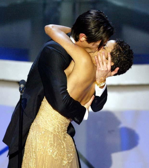 """Adrien Brody, the youngest performer ever to win the Best Actor award planted a passionate kiss on Halle Berry's lips after she presented him with the trophy. Adrien then remarked to Berry, """"Bet you didn't know that was in the gift bag."""""""