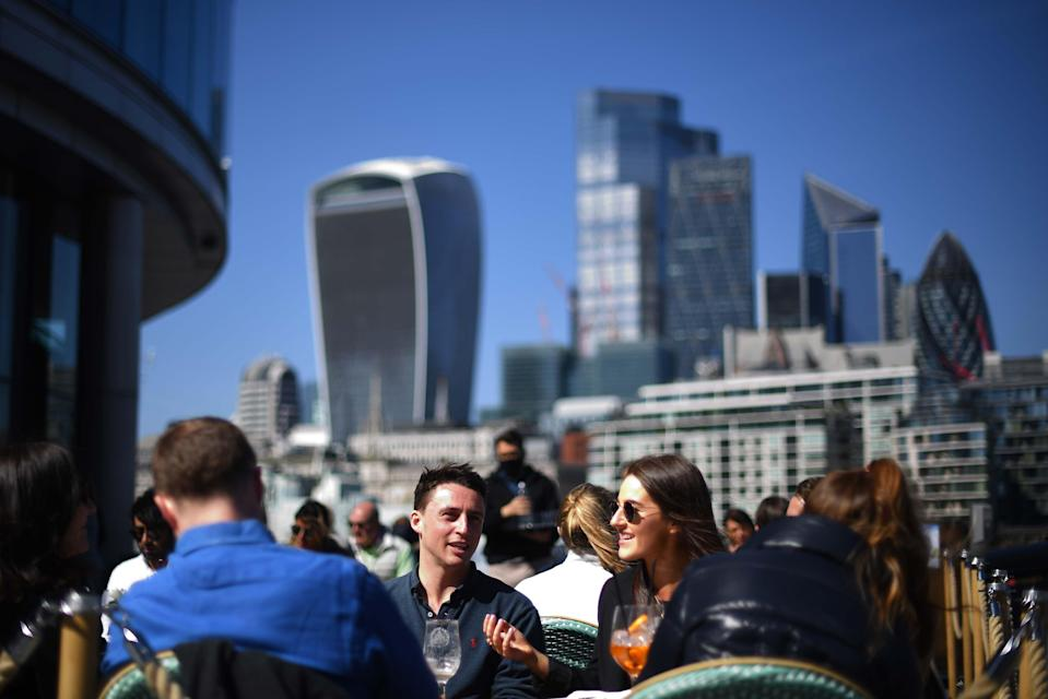 <p>Londoners taking advantage of the warm weather near Tower Bridge  last month</p> (PA)