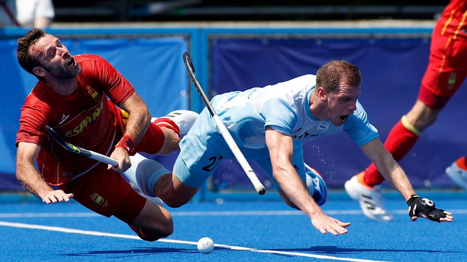 Tokyo 2020 Olympics - Hockey - Men's Pool A - Argentina v Spain - Oi Hockey Stadium, Tokyo, Japan - July 24, 2021. Lucas Rossi of Argentina in action with David Alegre of Spain. REUTERS/Phil Noble