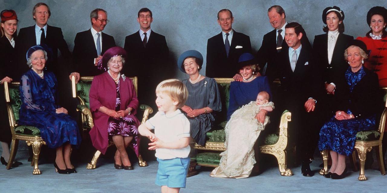 <p>A young Prince William makes the royal family laugh as they pose for photos at Prince Harry's christening. </p>