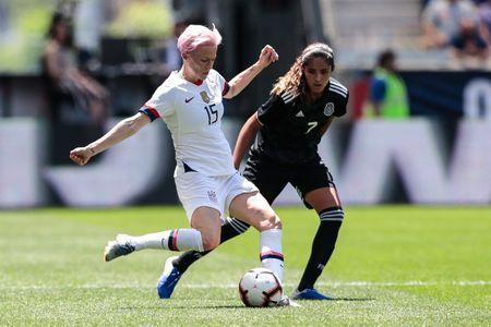 May 26, 2019; Harrison, NJ, USA; United States forward Megan Rapinoe (15) controls the ball as Mexico forward Daniella Espinosa (7) defends during the first half of a Countdown to the Cup Women's Soccer match at Red Bull Arena. Mandatory Credit: Vincent Carchietta-USA TODAY Sports