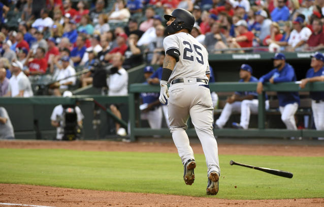 New York Yankees' Gleyber Torres watches his solo home run off Texas Rangers starting pitcher Cole Hamels during the third inning of a baseball game Tuesday, May 22, 2018, in Arlington, Texas. (AP Photo/Jeffrey McWhorter)