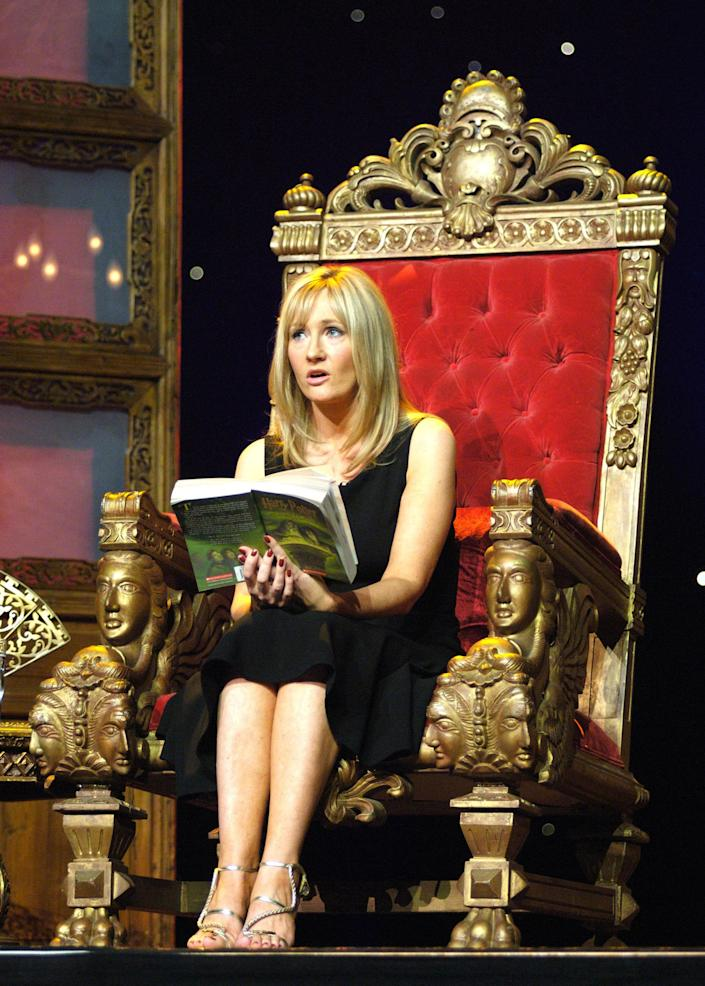 """FILE - This Aug. 1, 2006 file photo shows best-selling author J.K. Rowling reading from Harry Potter and the Half-Blood Prince during """"An Evening With Harry, Carrie & Garp,"""" at Radio City Music Hall in New York. At last, Harry Potter's adventures are available electronically. The seven novels about J.K. Rowling's boy wizard are for sale as e-books and audio books on the author's Pottermore website, the site's creators announced Tuesday March 27, 2012. The books are available only through the website, which says they are compatible with major electronic e-readers, including Amazon's Kindle and Sony's Reader, as well as with tablets and mobile phones. (AP Photo/Ann Billingsley, File) NO ARCHIVE"""