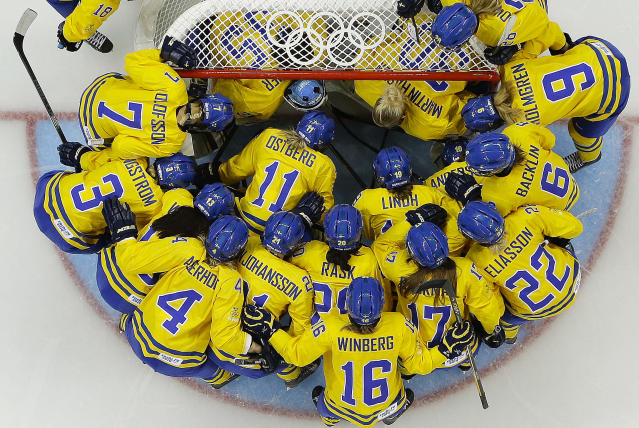 Team Sweden gathers around the net before playing the USA in the 2014 Winter Olympics women's semifinal ice hockey game at Shayba Arena Monday, Feb. 17, 2014, in Sochi, Russia. (AP Photo/Matt Slocum)
