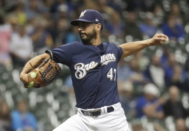 Milwaukee Brewers starting pitcher Gio Gonzalez throws during the first inning of a baseball game against the Cincinnati Reds Wednesday, Sept. 19, 2018, in Milwaukee. (AP Photo/Morry Gash)