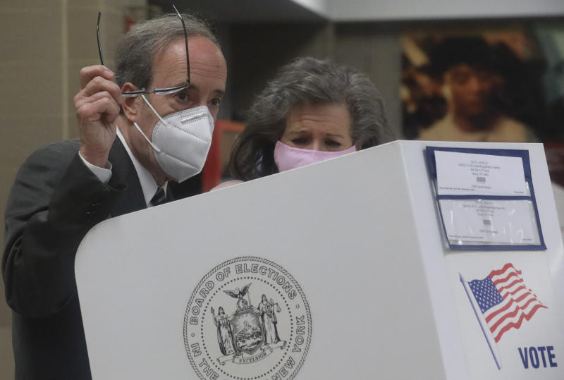 Pat Ennis Engel, right, stands with her husband Congressman Eliot Engel as he prepares to cast votes for primary elections Tuesday June 23, 2020, in the Riverdale section of New York. Engel is being challenged by former middle school principal Jamaal Bowman. (AP Photo/Bebeto Matthews)