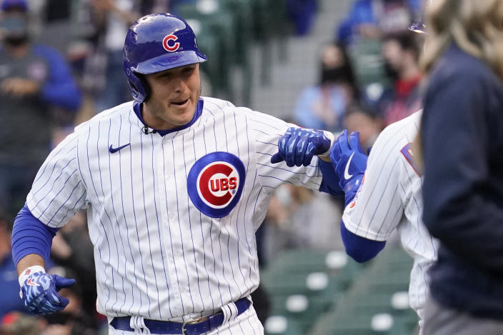 Chicago Cubs' Anthony Rizzo, left, smiles as he celebrates with Joc Pederson after hitting a solo home run during the first inning of a baseball game against the Atlanta Braves in Chicago, Sunday, April 18, 2021. (AP Photo/Nam Y. Huh)
