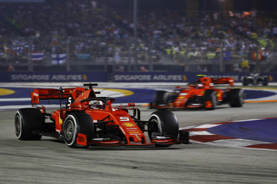 Ferrari driver Sebastian Vettel of Germany steers his car ahead of his teammate Charles Leclerc of Monaco as he on the way to win the Singapore Formula One Grand Prix, at the Marina Bay City Circuit in Singapore, Sunday, Sept. 22, 2019. (AP Photo/Eric To)