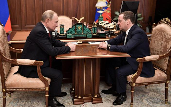 Russian President Vladimir Putin meets with Prime Minister Dmitry Medvedev in Moscow on Wednesday - AFP