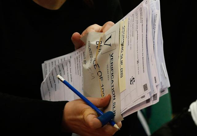 <p>Ballots are counted and verified by election staff, in the Magnet Leisure Centre Maidenhead, the constituency of Prime Minister Theresa May, in Maidenhead, England, Thursday, June 8, 2017. (Photo: Alastair Grant/AP) </p>